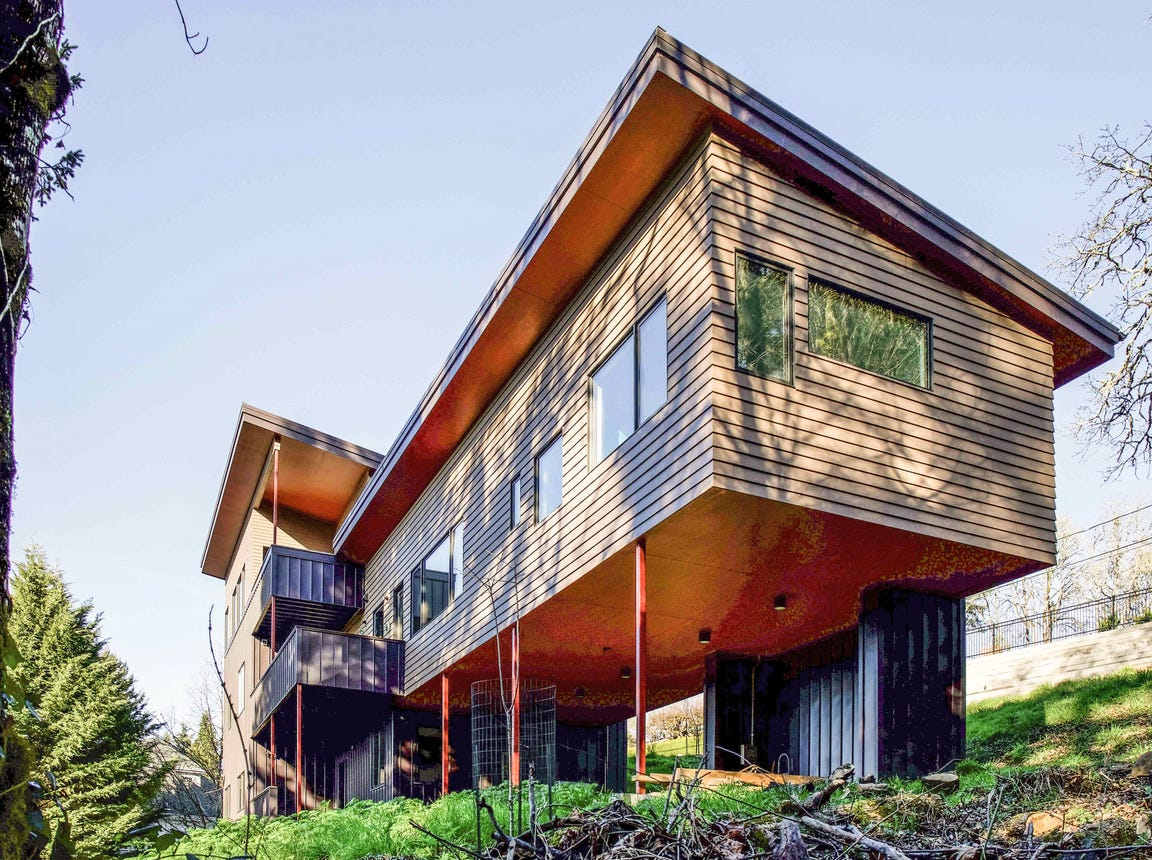 Nathan Good's recently completed residence in Salem demonstrates that a LEED Platinum-Certified green home can be built on a tight budget. The home features a number of locally-sourced products, including wood salvaged from old barns and water tanks