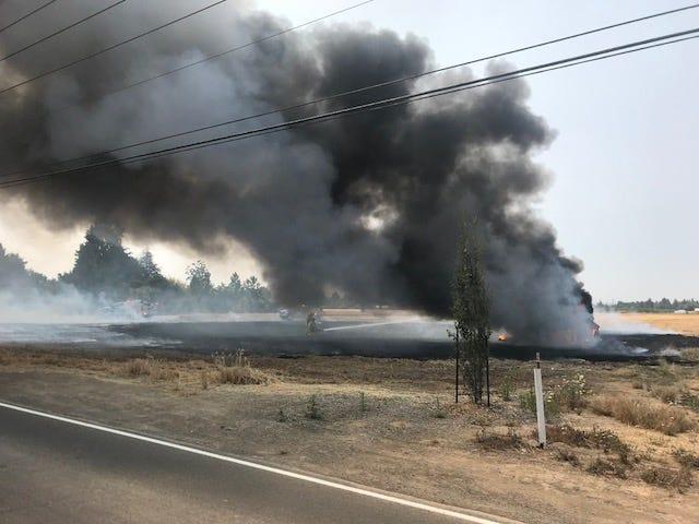 A field fire burns outside Keizer on Thursday, Aug. 9, 2018.