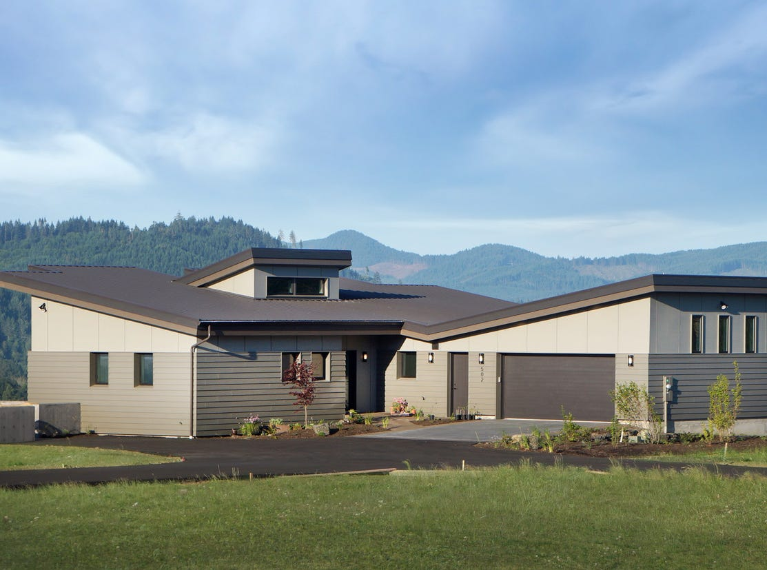 Nathan Good Architects utilized motorized sunshades in the Philomath Passive House to allow the residents to maintain the sweeping views atop the steep, sparse hill, while still maintaining energy efficiency.