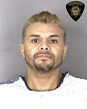 Jerry Borrego, 48, is charged with first-degree assault and robbery, two counts of attempted murder and felon in possession of a firearm and three counts of unlawful use of a weapon.