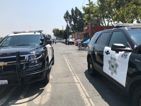Salinas police respond to a gunshot victim in Chinatown Thursday.