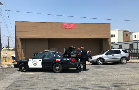 Salinas police respond to reports of a gunshot victim in Chinatown Thursday.