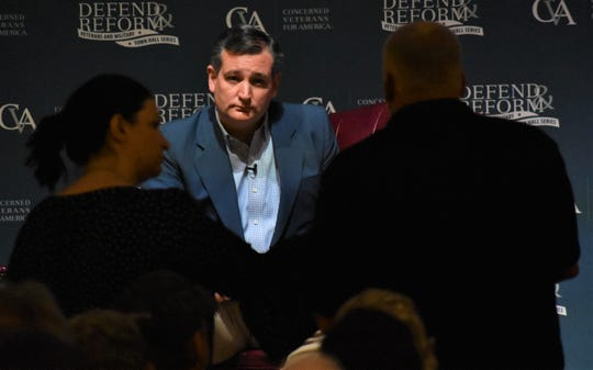 Sen. Ted Cruz listens to an audience member's question at a Concerned Veterans for American town hall on August 8, 2018 at The Heights church.