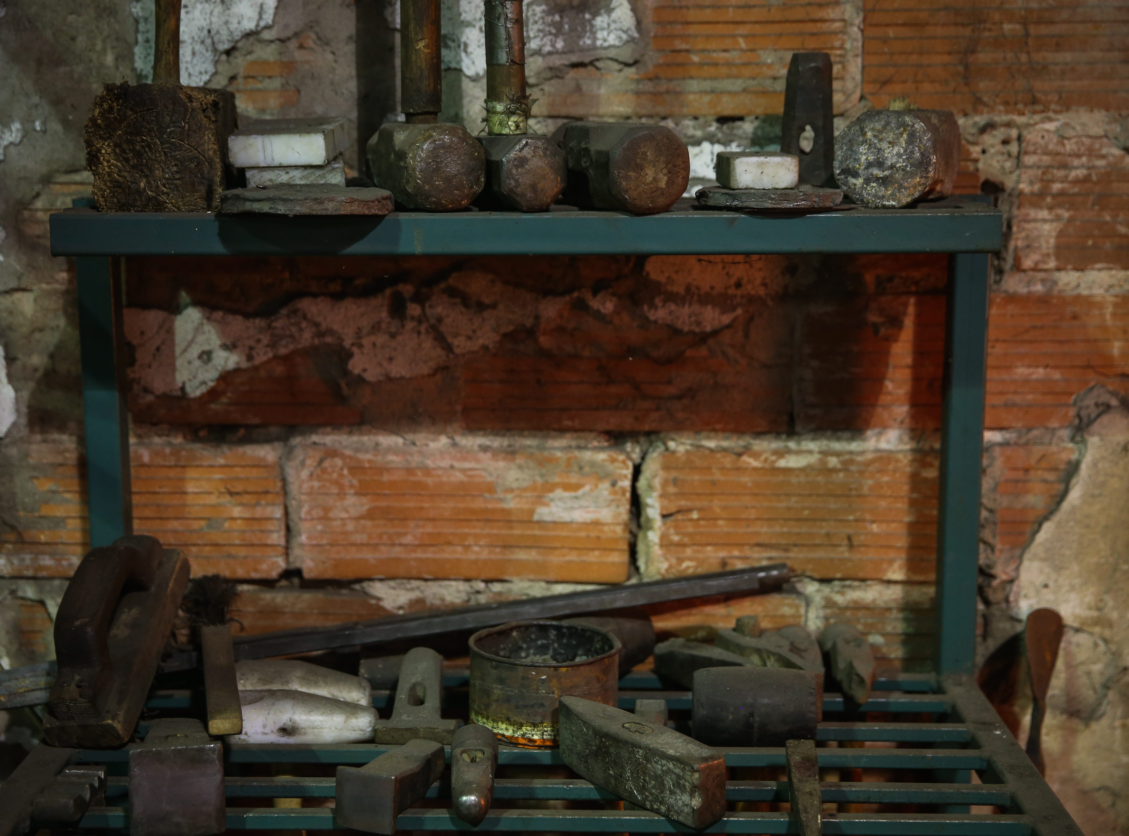 Various tools lay on a shelf in Randy Kiser's workshop Thursday, Aug. 2, 2018, at 3Nail Ironwork in Paint Rock.