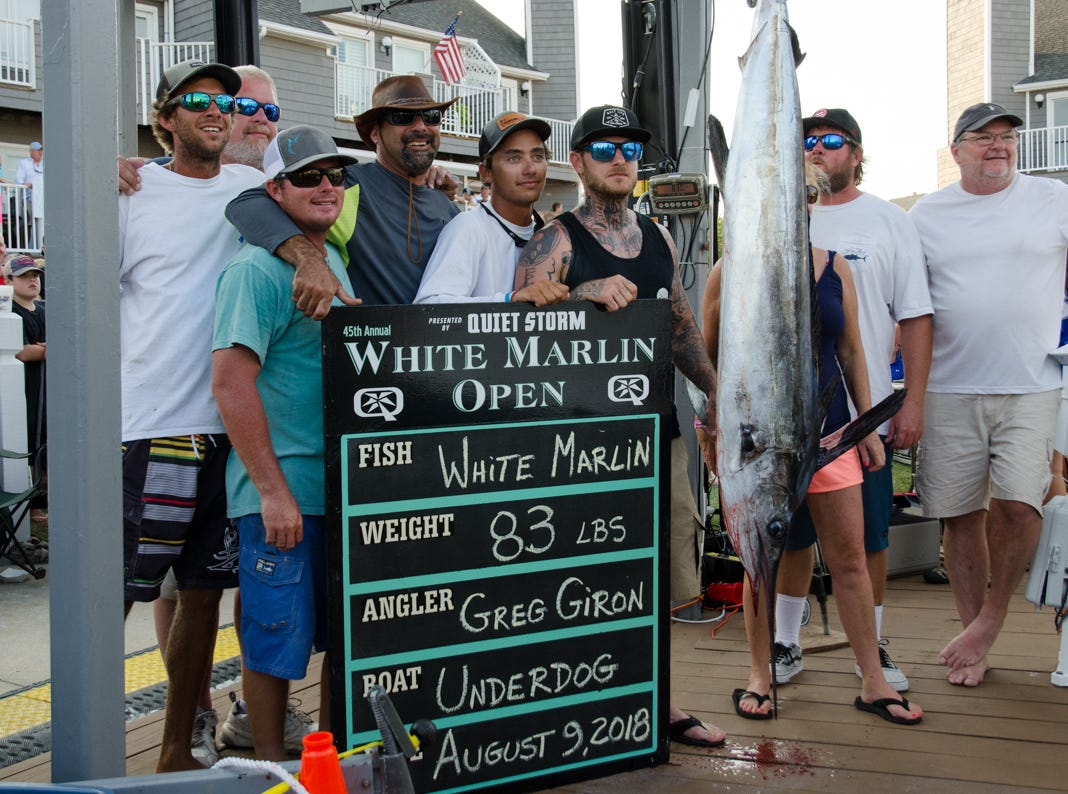 Angler Greg Giron aboard the Underdog with his white marlin at the scales. At 83 pounds, the fish took over first place in the white marlin category on Thursday.
