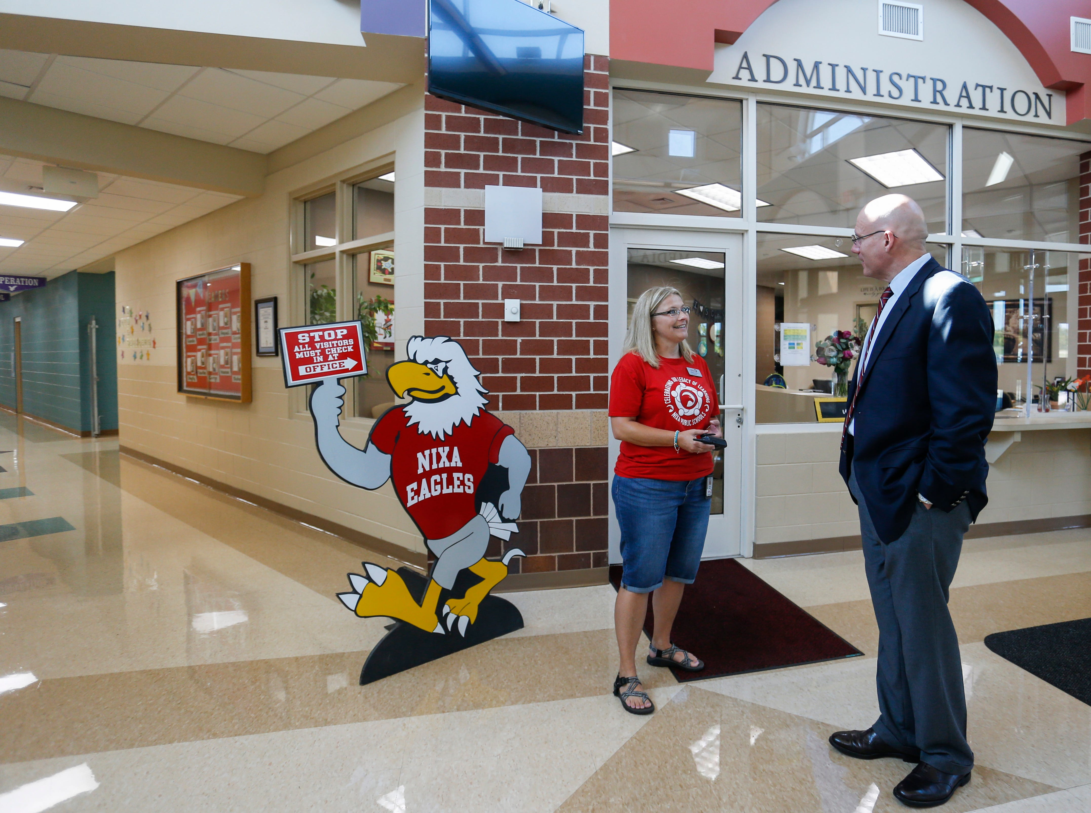 Nixa Superintendent Gearl Loden talks with High Pointe Elementary School Principal Marilyn Hanna on Thursday, August 9, 2018.