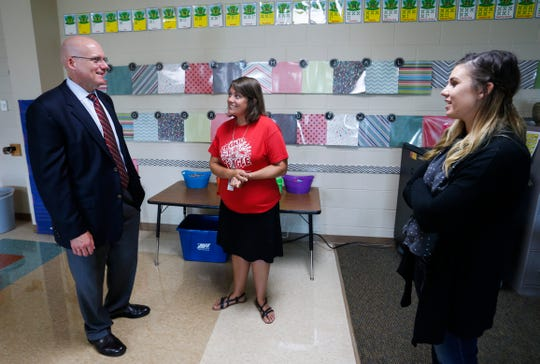 Nixa Superintendent Gearl Loden talks with High Pointe Elementary School kindergarten teacher Marie Johnston and intern Kelsey Woods on Thursday, August 9, 2018.