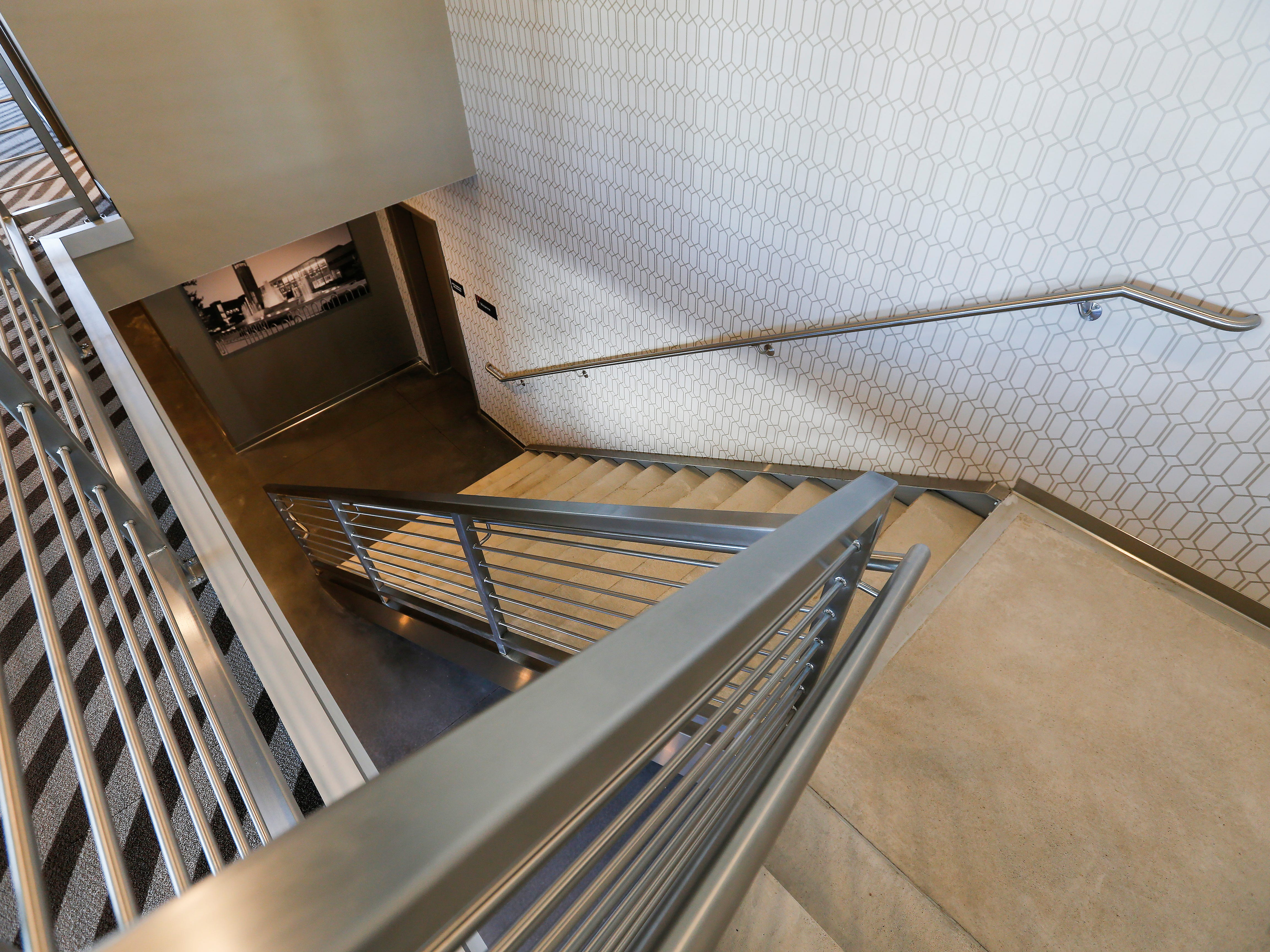A look down the stairs from the mezzanine level where the Zen Zone and fitness center are located at the new Vib Hotel, located at 1845 E Sunshine St. The hotel will hold its grand opening on Friday, Aug. 10, 2018.