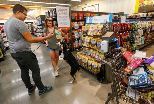 Melody, an Australian Shepherd, jumps up after Luis Peralta and Destinee Cordray picked out some treat for her at PetCo on Thursday, Aug. 9, 2018.