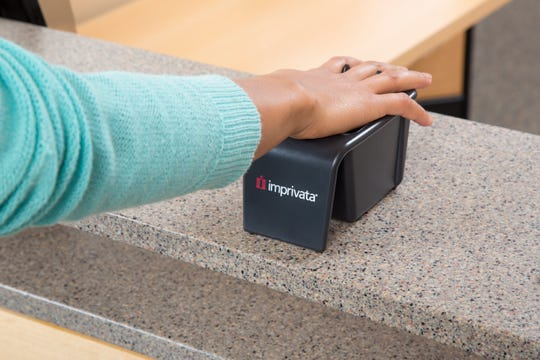 This is how CoxHealth patients will check in using a Imprivata Palm Reader.