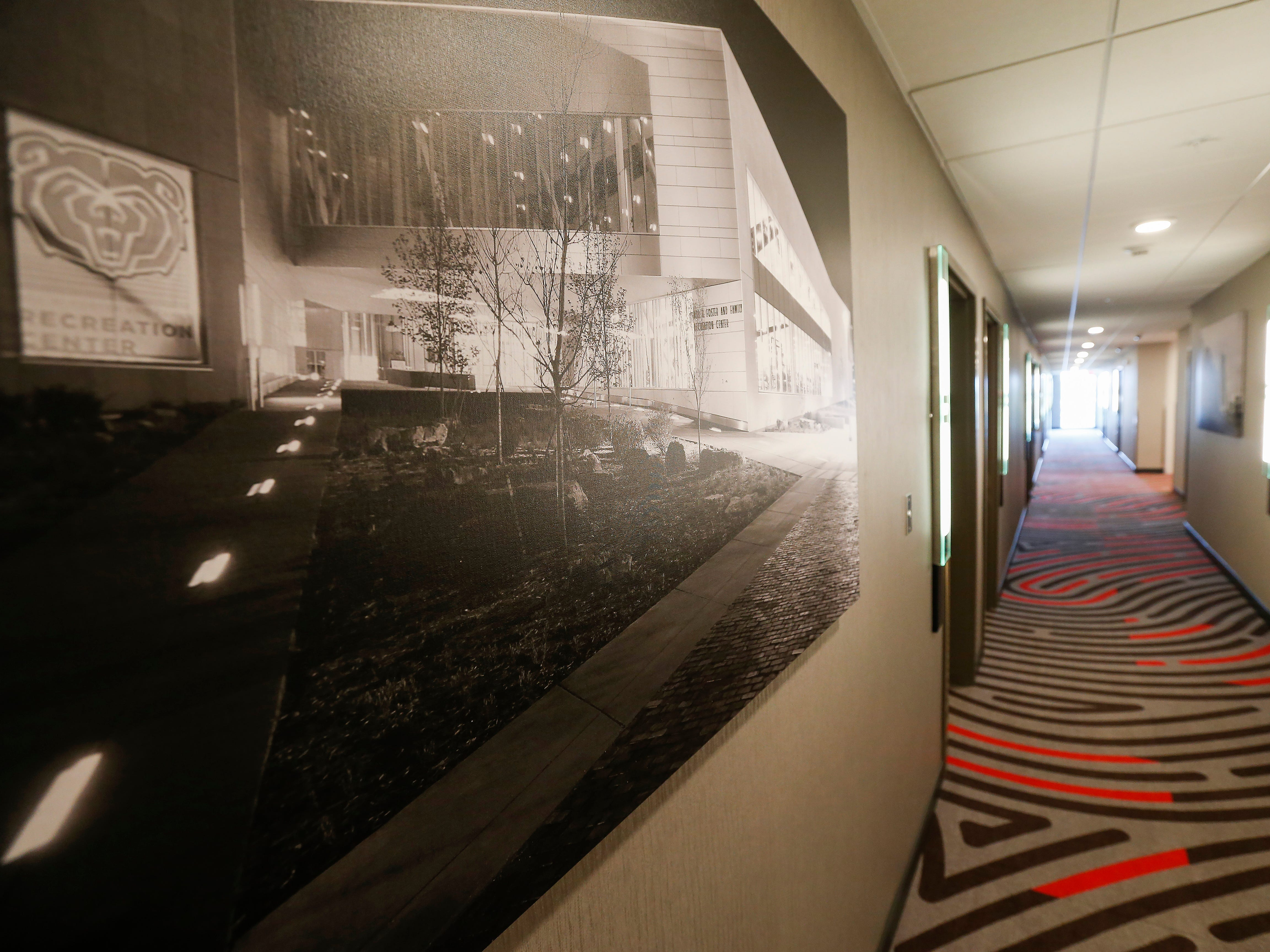 Photographs of local landmarks decorate the hallway walls at the new Vib Hotel, located at 1845 E Sunshine St. The hotel will hold its grand opening on Friday, Aug. 10, 2018.