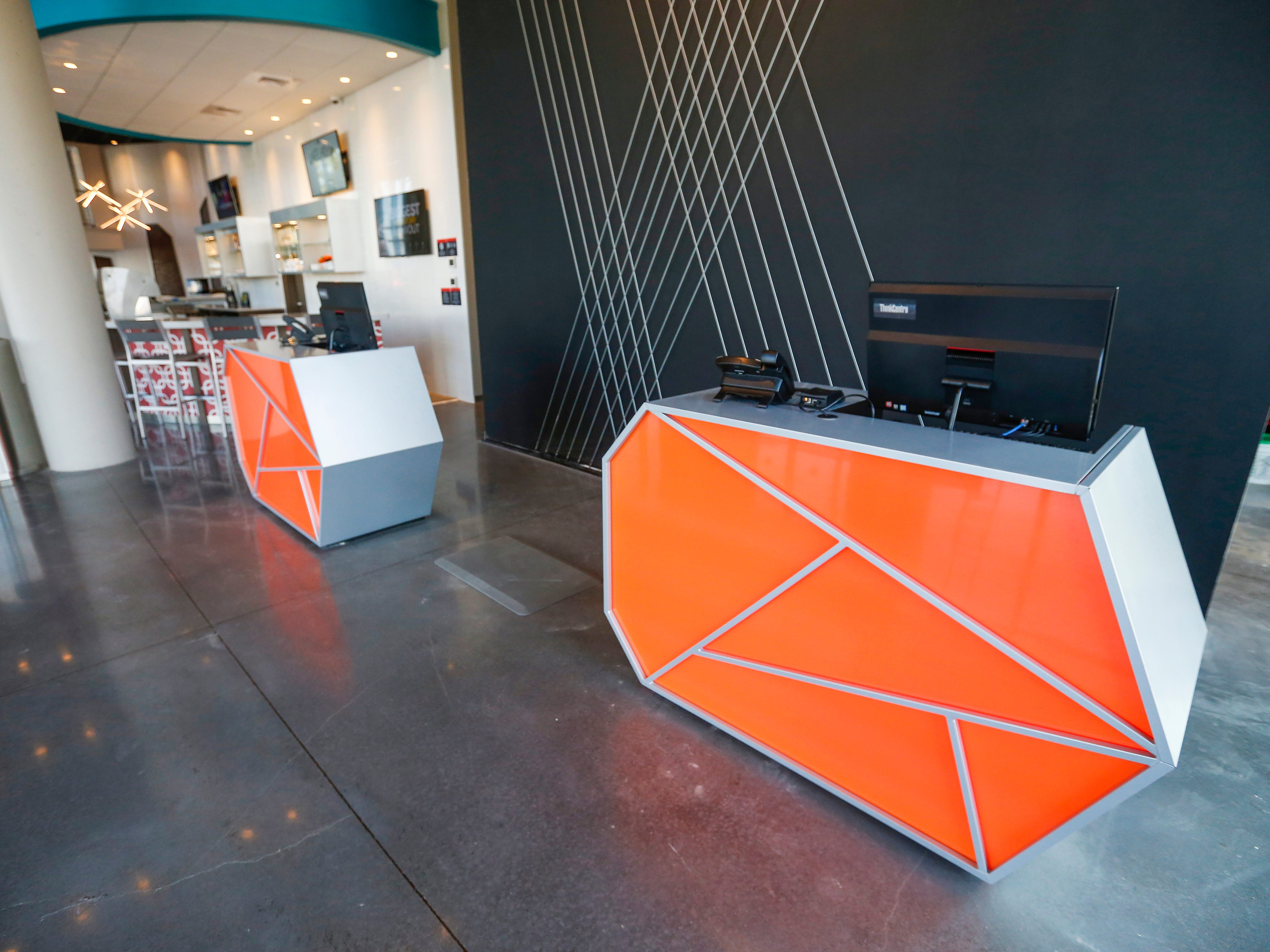 The registration pods inside the lobby at the new Vib Hotel, located at 1845 E Sunshine St. The hotel will hold its grand opening on Friday, Aug. 10, 2018.