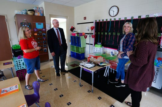 Nixa Superintendent Gearl Loden and High Pointe Elementary School Principal Marilyn Hanna talk with kindergarten teacher Sarah Pollack and intern Bailey Jennings on Thursday, August 9, 2018.