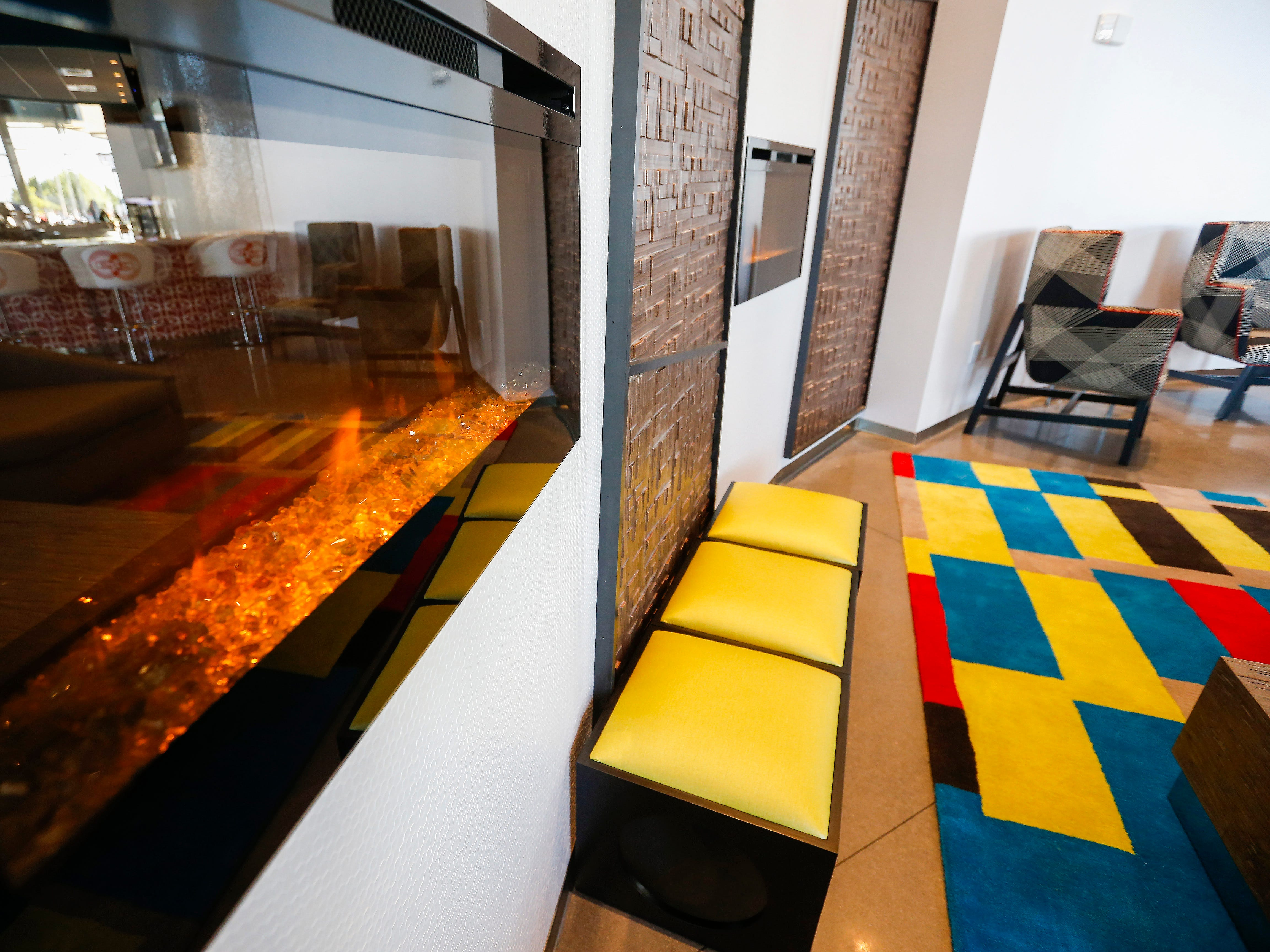 Two fireplaces highlight a seating area in the lobby at the new Vib Hotel, located at 1845 E Sunshine St. The hotel will hold its grand opening on Friday, Aug. 10, 2018.