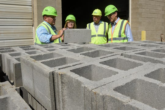 Governor candidate Tim Pawlenty and Lt. Gov. Michelle Fischbach talk with Thor Becken and John Pederson of Amcon Block & Precast during a tour Thursday, Aug. 9, in St. Cloud.