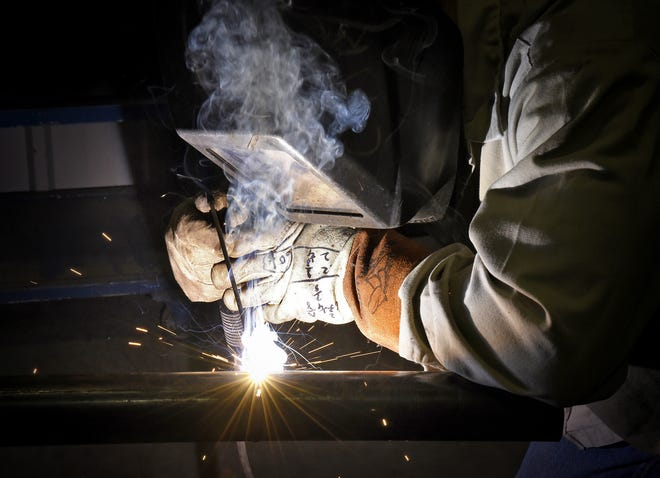 A welder works on a section of pipe in a Sauk Rapids factory in this file photo. Career Solutions is offering a free manufacturing careers academy this coming fall to help fill in-demand welding and machinist job openings.
