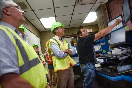 Candidate for Minnesota governor Tim Pawlenty is shown how the dispatch center works during a tour of Amcon Block & Precast Thursday, Aug. 9, in St. Cloud.