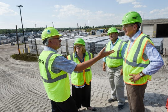 Governor candidate Tim Pawlenty and Lt. Gov. Michelle Fischbach talk with Thor Becken and John Pederson of Amcon Block & Precast about the business Thursday, Aug. 9, in St. Cloud.