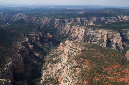 This May 8, 2017, file photo shows Arch Canyon within Bears Ears National Monument in Utah. A judge says the U.S. government doesn't have to turn over documents to an environmental law firm about legal arguments behind President Donald Trump's decision to shrink national monuments. U.S. District Judge David Nye ruled Monday, Aug. 6, 2018, that the records are protected presidential communications.