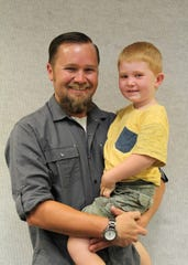 Jaden Benson was named Cedar City employee of the month on Aug. 8, 2018. Brodie, 3, joined his dad for the presentation at Wednesday's council meeting.