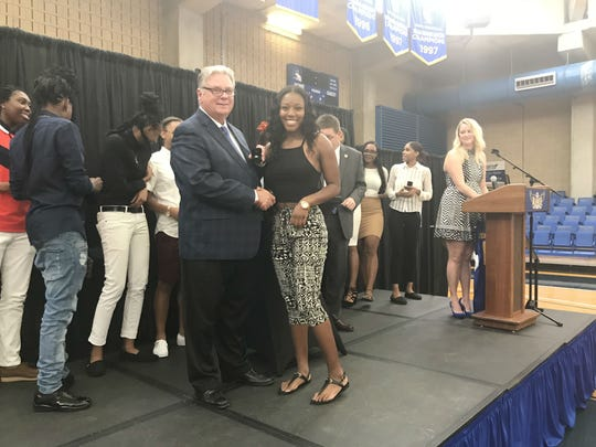 TCC guard Aliyah Lawson receives her national championship ring from President Dr. Jim Murdaugh during a title celebration inside the Eagledome on Aug. 8, 2018.
