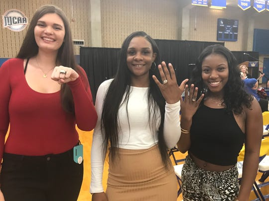 From left to right: Lynnsey Cranmer, Jamyra McChristine and Aliyah Lawson show off their national championship rings.