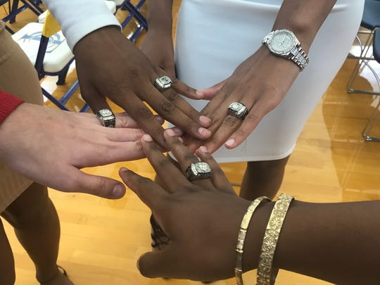 From left to right: Lynnsey Cranmer, Jamyra McChristine, Jada Perry and Aliyah Lawson showcase their new jewelry.