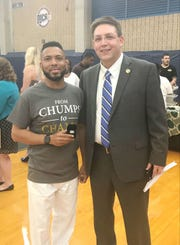 """Former TCC women's basketball head coach Franqua """"Q"""" Bedell shares a glorious moment with athletics director Rob Chaney during the celebration to honor the national championship."""