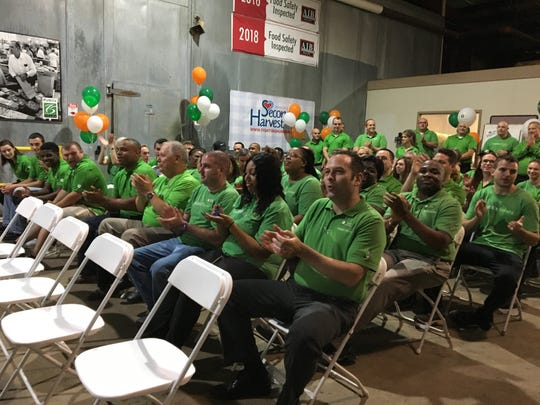 Publix employees cheer at a press conference Thursday announcing a $100,000 grant award to Second Harvest of the Big Bend from Publix Charities.