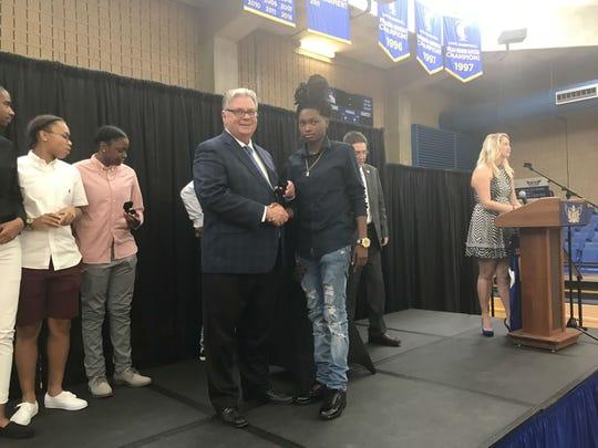 Eagles guard Juliunn Redmond receives her championship ring from TCC president Dr. Jim Murdaugh.