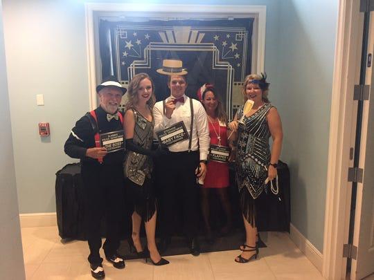 Gary Malone, left, Katie Raiff, Michael Nottage, Dawn Preller and Robin Raiff at the 2018 RealtorsAssociation of Indian River County Habitat Auction.