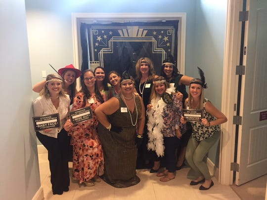 Tiffany Battle, left, Shannon Pohl, Traci Hatch, Christy Graham, Jessica Kurutz, Abby Bass, Lynda Gibson, Lucy Kranker, Jovana Pena and Taryn Plaumbo at the 2018 Realtors Association of Indian River County Habitat Auction.