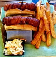 Blue Pointe Bar and Grill's First Mate Frank was two dogs wrapped in bacon and deep fried and served onbutter toasted New England style buns. It was accompanied by coleslaw, a pickle spear and bottleneck fries.