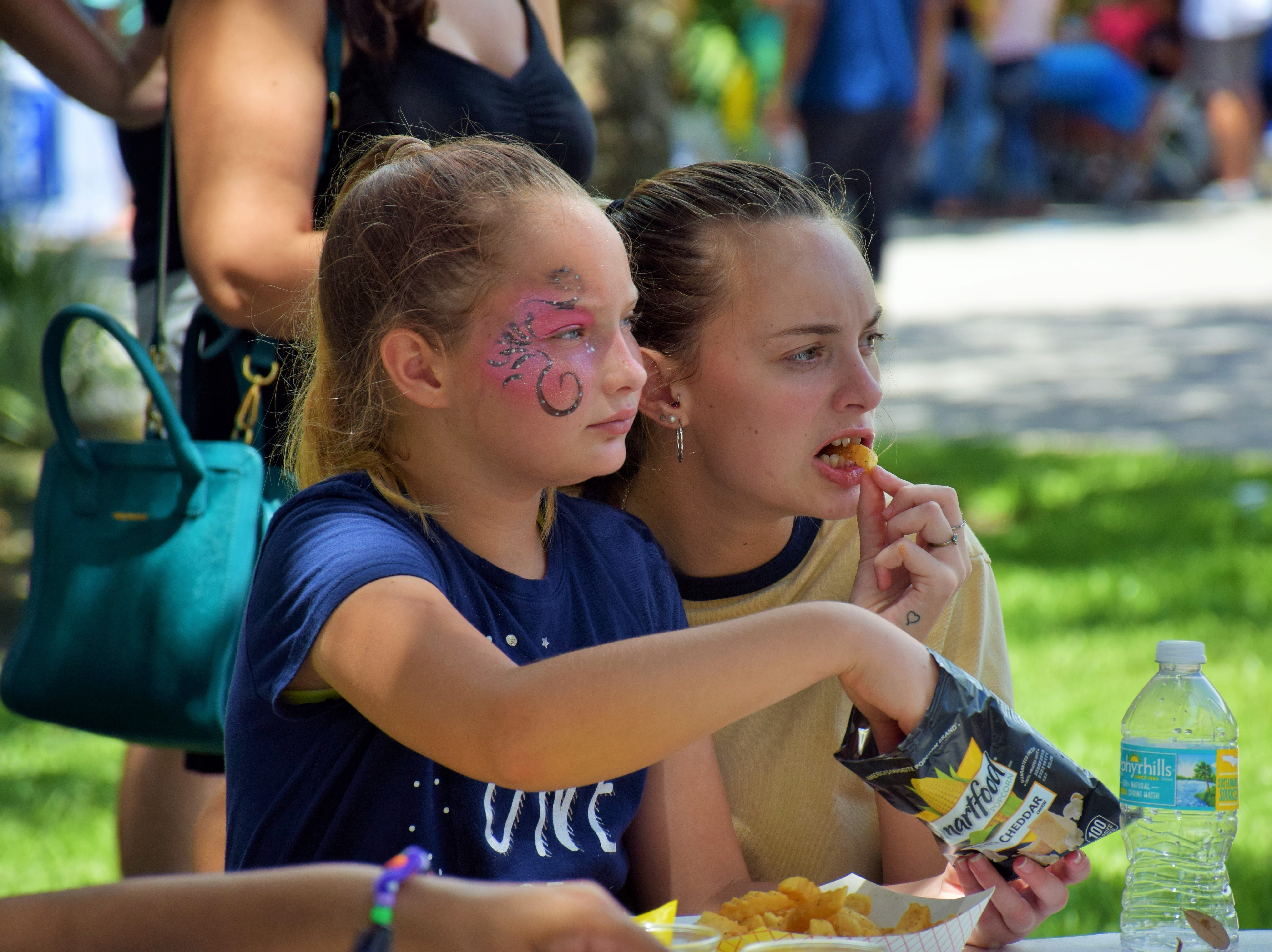 Sisters Paige and Jayna enjoy the food and entertainment.