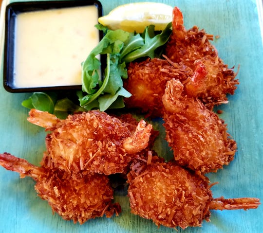Blue Pointe Bar and Grill's  Pina Colada Shrimp was half dozen large coconut shrimp served with a house made pineapple dipping sauce.