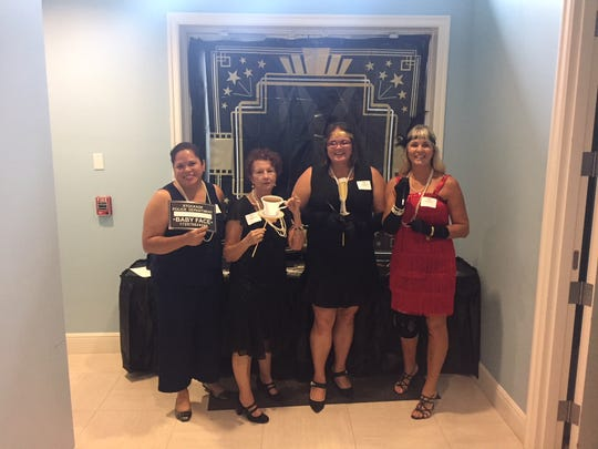 Mariela Sanchez, left, Paula Zaluski, Tiffany Buckels and Opey Angelone at the 2018 Realtors Association of Indian River County Habitat Auction to benefit Indian River County Habitat for Humanity.