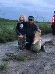 Curtis Bishop, 3, and dad, Chris Bishop, of Stuart, pose with an alligator they hunted during the 2017 alligator hunt season.