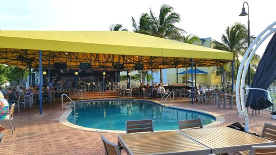 Blue Pointe Bar and Grill is behind the Jupiter Pointe Club and Marina in Tequesta and has a swimming pool for its patrons.