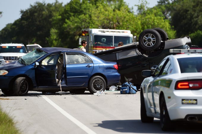 Law enforcement officials investigate the cause of a two-vehicle crash Thursday, Aug. 9, 2018 at the intersection of 77th Street and Old Dixie Highway in Indian River County. Two people were transported to Lawnwood Regional Medical Center & Heart Institute in Fort Pierce and a third was taken to Indian River Medical Center in Vero Beach.