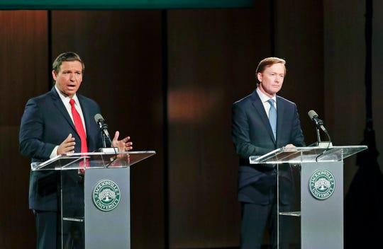 Republican gubernatorial candidates Ron DeSantis, left, debates Adam Putnam on Aug. 8, 2018, in Jacksonville.