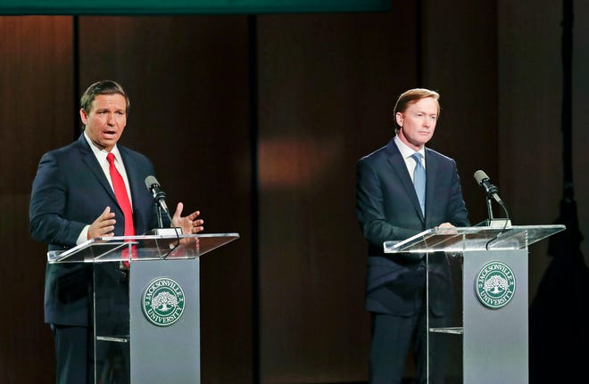 """Republican gubernatorial candidates Ron DeSantis, left, and Adam Putnam, who debated Aug. 8, 2018, in Jacksonville, might have been Floridians top two candidates for governor that year had the state used the so-called """"jungle primary"""" system. Approving proposed constitutional Amendment 3 on the Nov. 3 ballot would allow people of all parties to run in a state primary, with the top two regardless of party proceeding to the general election."""