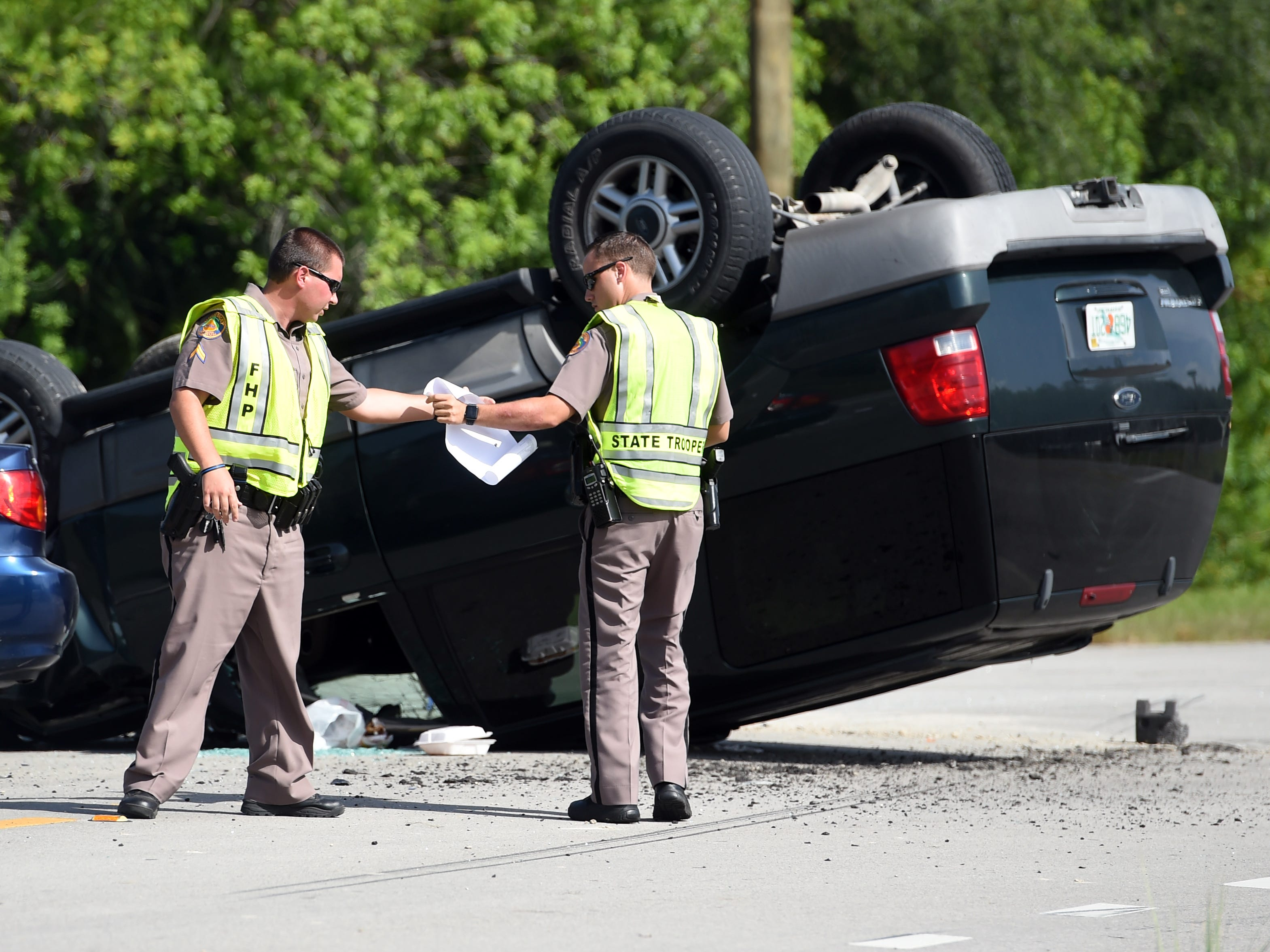 Three people were transported to area hospitals after a two-car crash Thursday, Aug. 9, 2018 at the intersection of 77th Street and Old Dixie Highway.