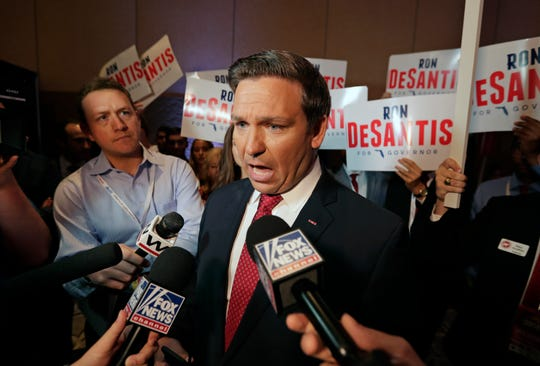 U.S. Rep. Ron DeSantis speaks to reporters June 28, 2018, after a Florida Republican gubernatorial primary debate at the Republican Sunshine Summit in Kissimmee.