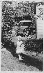 Rita (Harter) McGinnis, in 1918 with The Machine, as the family called their car.