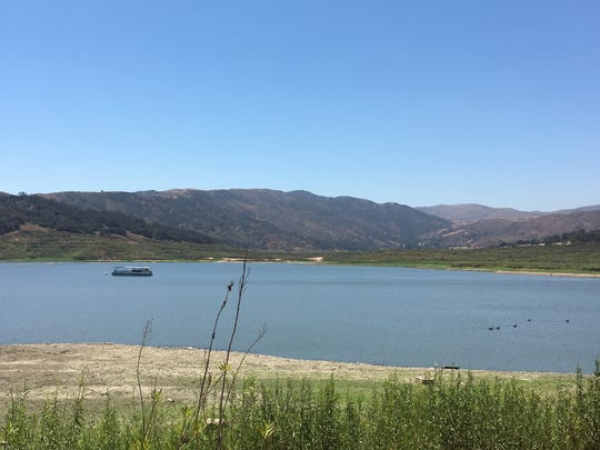 A boat and ducks in a drought-stressed Lake Casitas. As of Wednesday, the lake was close to 33 percent of capacity.