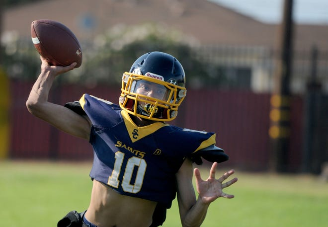 Quarterback Robert Rush prepares to fire a pass during a Santa Clara High practice.