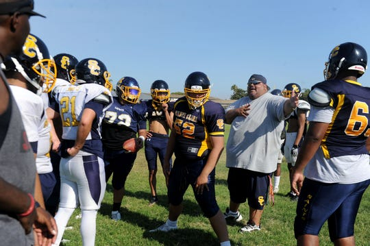 Head coach Tony Vazquez, middle, gives instructions to his team during a Santa Clara High practice.