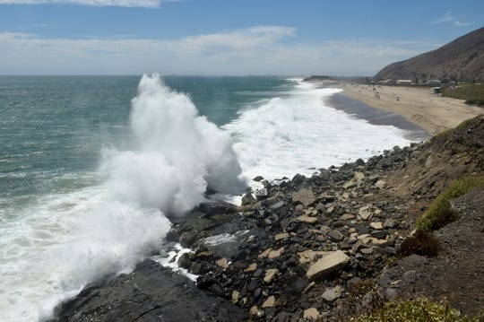 Water crashes over the rocks at Point Mugu State Beach.