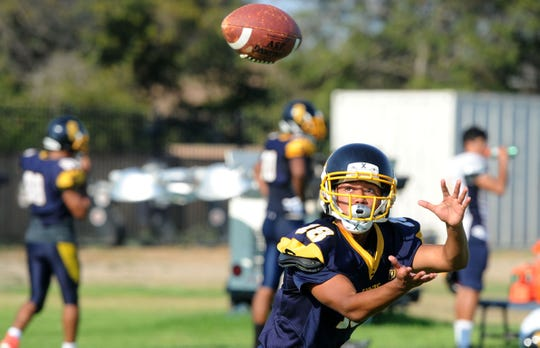 Issac Mejia has his focus completely on the ball while making a catch during a Santa Clara High practice.