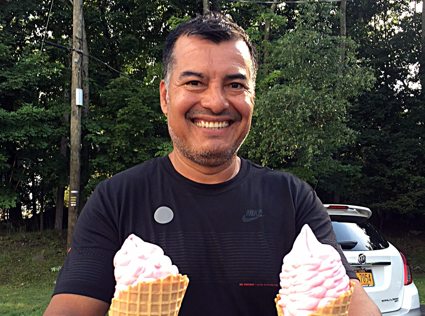 """No, they are not both for me... I wish it was. It's actually for my co-worker."" states Mateo Alvarez after purchasing two strawberry ice cream treats from Hoyer's ice cream stand in West Haverstraw Aug. 8, 2018."